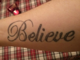 tattoo on right arm as a reminder to believe