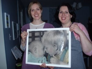 My sister and I in 2009 holding a picture of us